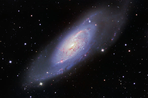M106 Spiral Galaxy harboring our nearest extragalactic jet taken with clear red green blue filter set and hydrogen alpha filters