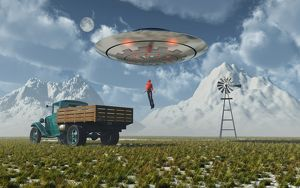 Aliens abducting a man into a flying saucer