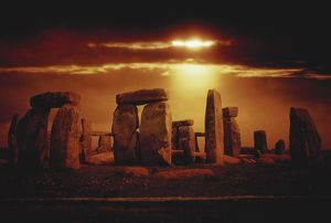 Composite of a sunset over Stonehenge, Wiltshire, England