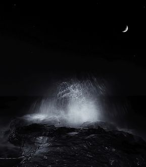 The crescent moon and waves splashing over rocks in Miramar, Argentina