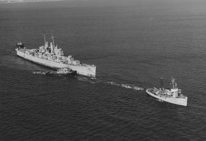 Ex-USS Vincennes is towed out of San Diego Bay, California, by USS Kalmia, 1969