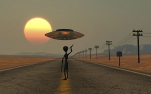 A Grey Alien hitching a ride from a passing UFO