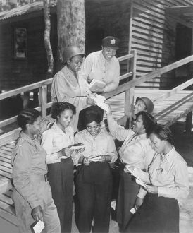 A group of nurses receiving their first batch of mail from home while in Australia