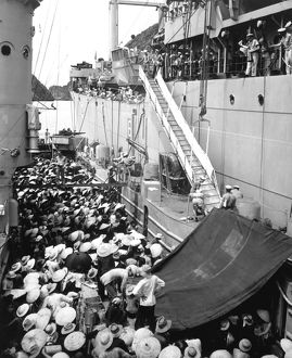 Refugees wait to board a ship in Haiphong, Vietnam, 1954