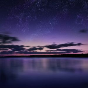 Tranquil lake against starry sky, Russia