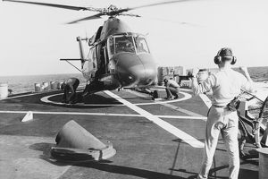 A UH-2 Seasprite helicopter lands aboard USS Coontz, 1969