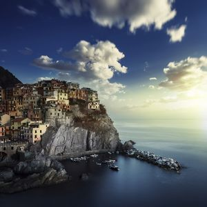 View of Manarola on the rocks at sunset, La Spezia, Liguria, Northern Italy
