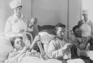 Wounded soldiers knitting under the watchful eye of nurses