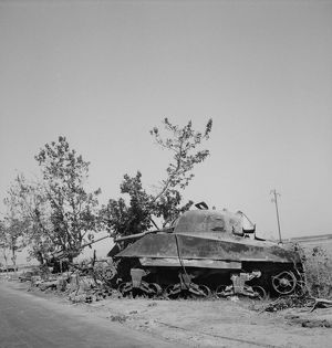 Wreckage of a General Sherman tank and a German 88mm gun, Sicily, 1943